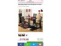 BLACK OVAL DINING TABLE WITH 4 LEATHER CHAIRS
