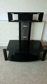 """Black glass TV stand holds up to 42"""""""