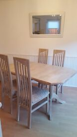 REDUCED Limed oak extending dining room table with four high back chairs. Good condition. £120 ono