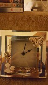 Beautiful silver clock from M and S. Selling for £5. Collect only!