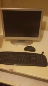 Computer monitor for sale (with a wireless mouse and keyboard included!)