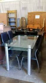 Glass Dining Table and 4 faux leather chairs - Delivery Available