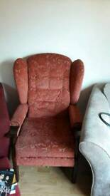 Slim upright chair very comfy and easy to get in and out of .