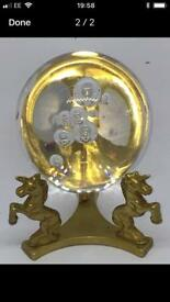 Crystal ball and brass unicorn stand