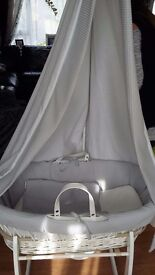 Nearly new baby moses basket with canopy