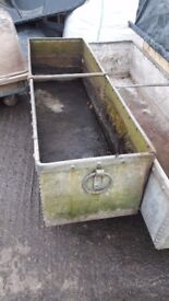 Large early 20th century riveted galvanised water trough with tethering rings