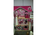 Wooden dolls house and furniture huge really sturdy in good condition.