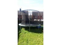 10ft outdoor trampoline, with net but that does have a few holes in, including a big one