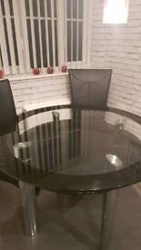 Harvey's glass round dining table