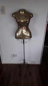 Ornate clothes stand