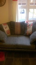 2 two seater sofas grey cord and leather both the same good condition must be able to collect