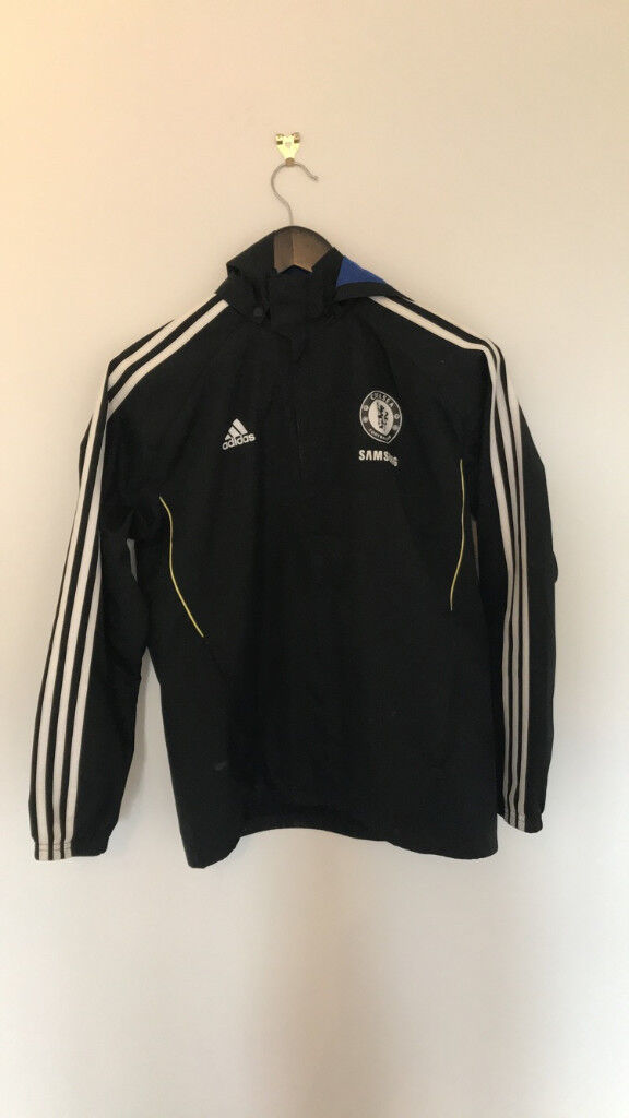 Adidas Cheslea rain jacket, front zip and hood, almost new. Size 13-14 years.