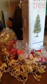 6ft artificial christmas tree with lights and decorations.