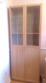 IKEA Display Shelving Unit In Light Oak, Glass Doors