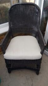 Wicker Chair with seat cushion. Must be seen to be appreciated.