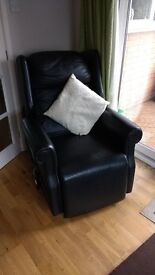 Rise and recline electric black leather chair
