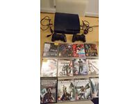 PS3, 2 official controllers and 12 games