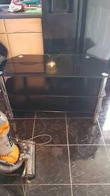 """Black glass table tv stand 50"""" tv on it previously."""