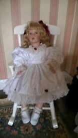China doll in rocking chair