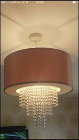 Beige lampshade with droplet pendant