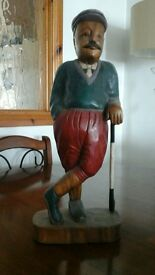 wooden statue of golfer