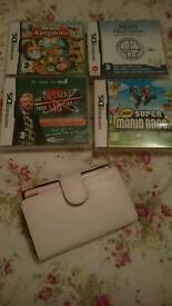 Pink Nintendo DS Lite console with 4 games