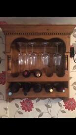 Bespoke wooden wall mounted wine rack .
