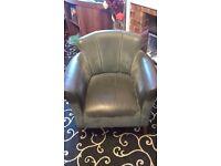 Dark green leather armchair