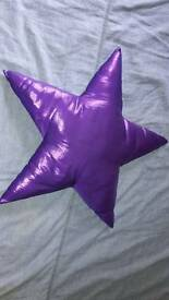 Metalic purple star decorative cushion