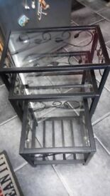Nest of 3 tables. Black metal and glass.