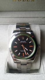 rolex milgauss black face orange sweeping hand sapphire glass waterproof tested heavy weight 150 g