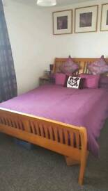 Used wooden sleigh bed
