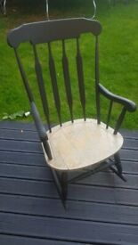 Lovely rocking chair painted in black.