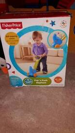 Pop and push elephant toy