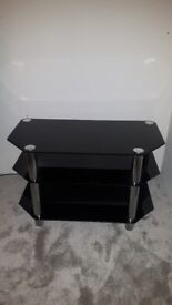 Black glass tv stand in very good condition STILL AVAILABLE