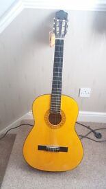 Accoustic guitar for sale including spare strings