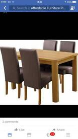 Dining table and four upholstered chairs