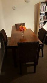 Oak polished dining table and chairs
