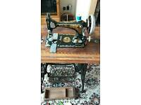 Singer treadle sewing machine with attachments