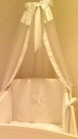 White chiffon drapes with pale blue and metal pole