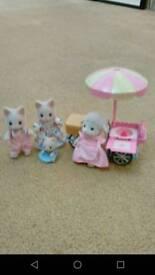 Sylvanian cat family and candy floss cart.