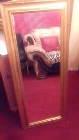 Full length gold framed mirror