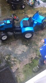 Boys ride on tractor