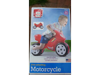 Childrens freewheeling motocycle balance bike early learning centre never been used