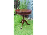 Regency drum sidetable with three drawers