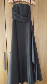 Prom dress black stunning when worn . Sizec8
