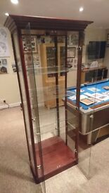 Glass shelved display unit