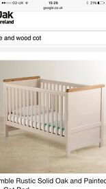 White/cream and wood top cot bed.