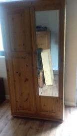 Two solid pine wardrobes in good condition