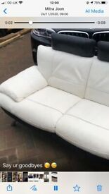 Nice two three sitter leather , black and white good condition